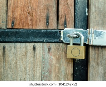 lock and key. Old wood door. plank texture and Letf copy space for text