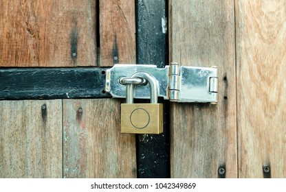 lock and key. Old wood door. plank texture and copy space for text