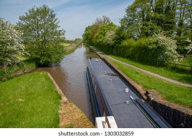Lock with a leaving narrowboat on the LLangollen Canal in Shropshire, UK