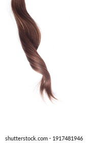 a lock of natural brunette hair on a white background