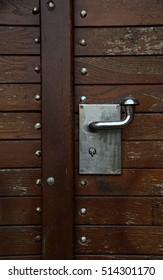 The lock on brown door