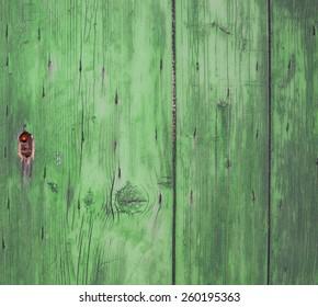 lock on green wooden door