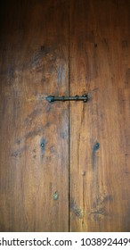 The lock on old wooden door
