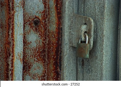 Lock on a rusted door at Lambertsbaai, South Africa on a misty day