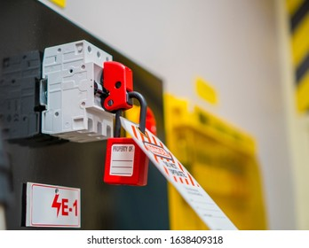 Lock Out, Tag Out with a danger tag. Electrical and machine system and safety equipment. There is a Danger and Do Not Remove warning. Switch Lock.