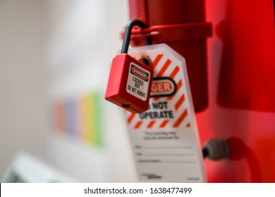 Lock Out, Tag Out with a danger tag. Electrical and machine system and safety equipment. There is a Danger and Do Not Remove warning. Plug Lock. - Shutterstock ID 1638477499