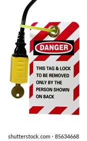 lock out tag out sign and lock on an electrical cord isolated with clipping path at original size