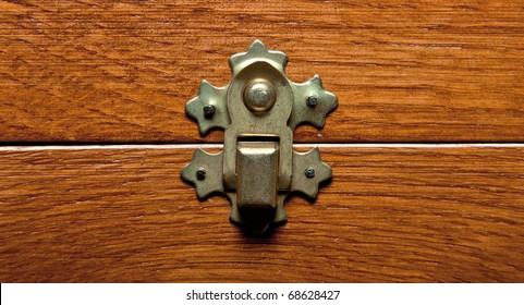 The lock of a wooden casket close up