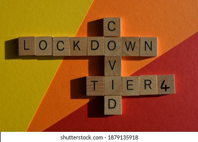 Lockdown, Covid, Tier 4, words in wooden letters in crossword form isolated on colourful background