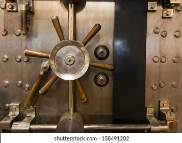 Locked bank vault door in retail store safe secure storage locker