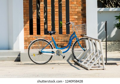 Locked bicycle at bicycle parking near the house