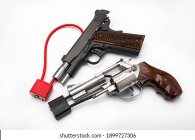 Locked disarmed and secured semi automatic hand gun and revolver pistol gun  on white background , Gun control , Gun Safety concept