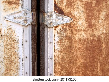 Locked door from an old rusty container