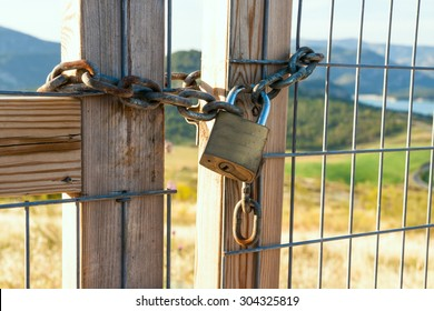 Locked gate on beautiful landscape