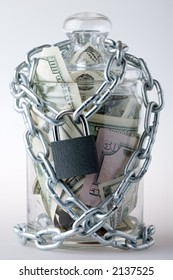 Locked glass jar full of the American banknotes.