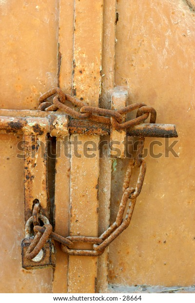 Locked up and gone away - and old gate secured by a rusty padlock
