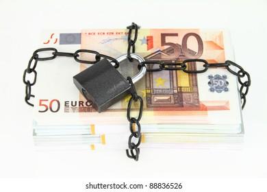 Locked money on white background