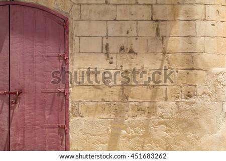 Locked red wooden doubledoor