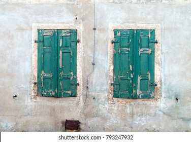 locked shutters on an old house