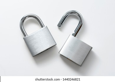 Locked and unlocked silver padlock on the white background.