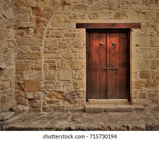Locked wooden door in the ancient building, Mediterranean style.