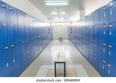 Locker room with bench.