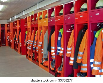 Locker room of a fire department with protection uniforms and helmets.