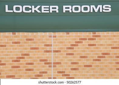 Locker Rooms sign at a football field