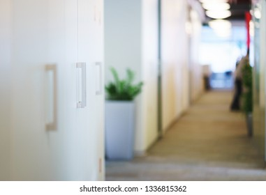 Lockers for documents and personal items in the workspace. Modern office and room design for employees. Glass office partitions and unrecognizable interior. Soft focus and beautiful bokeh.