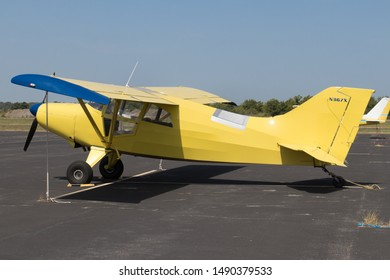 Lockhart, Texas - 31 July 2019: a yellow MAULE M-5-210C single enghine plane built in 1976