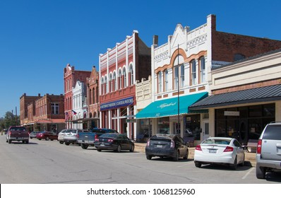 LOCKHART, TEXAS -  MARCH 7 2018: small Texas downtown street lined with vehicles