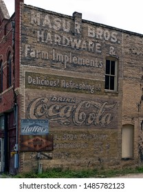 Lockhart, Texas / USA - July 5 2006: Masur Bros. Hardware and Farm Implements Ghost sign on the side of a building in the town center.