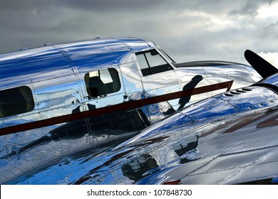 Lockheed Electra Jr. - A perspective view of a vintage Lockheed Electra Jr.. A polished and shiny fuselage; the essence of the golden era of aviation.