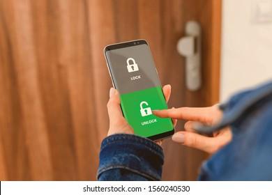 Locking door using mobile application. - Shutterstock ID 1560240530