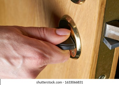Locking up or unlocking door with key in hand - Shutterstock ID 1633066831