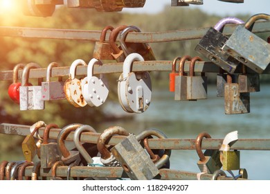 Locks of lovers abstract on the bridge close up.