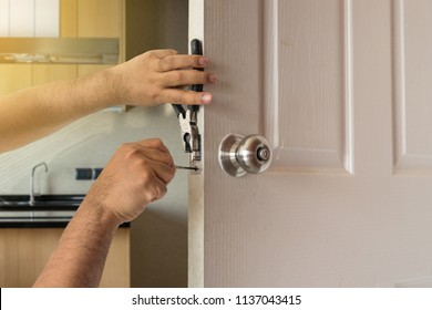 locksmith fix door by screwdriver in kitchen house and lighting fare effect