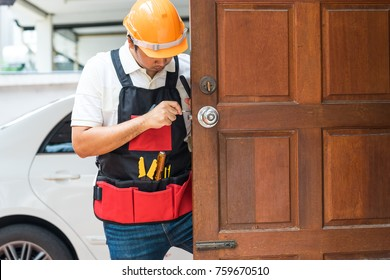 locksmith and handyman tool repair old knob on wood door for key house service concept