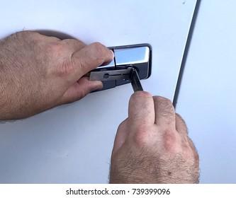 Locksmith opening car door