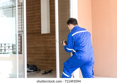 locksmith repair white slide door by drill - can use to display or montage on product