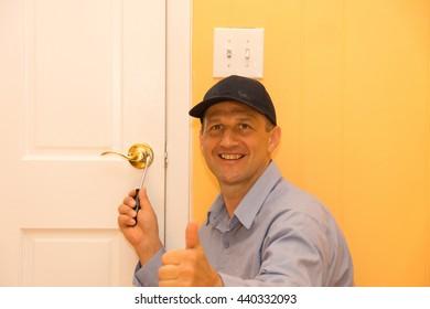 Locksmith repairs door lock