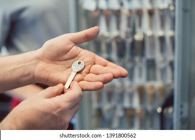 Locksmith showing key blanks in his shop