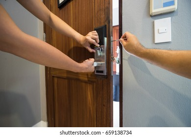 locksmith team fix smart lock on wood door by screwdriver - can use to display or montage on product