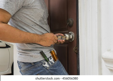 locksmith try to open the door with key maker tool and screwdriver - can use to display or montage on product