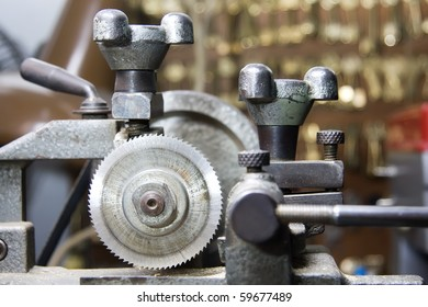 Locksmiths machine with blurred background of keys