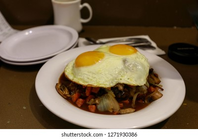 Loco Moco , traditional Hawaiian cuisine , burger patty on rice with a fried egg and brown gravy sauce - Image