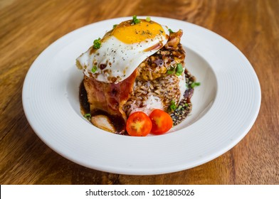 Loco Moco, a traditional Hawaiian dish of ground beef patty and a fried egg on a bed of rice, in gravy