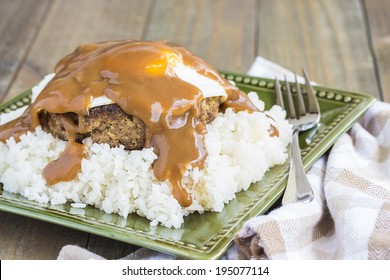 Loco Moco, a traditional Hawaiian dish of teriyaki flavored ground beef patty and a fried egg on a bed of rice, smothered in gravy
