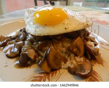 Loco Moco, white rice, hamburger patty, gravy and topped with fried egg