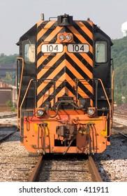 Locomotive in rail yard.